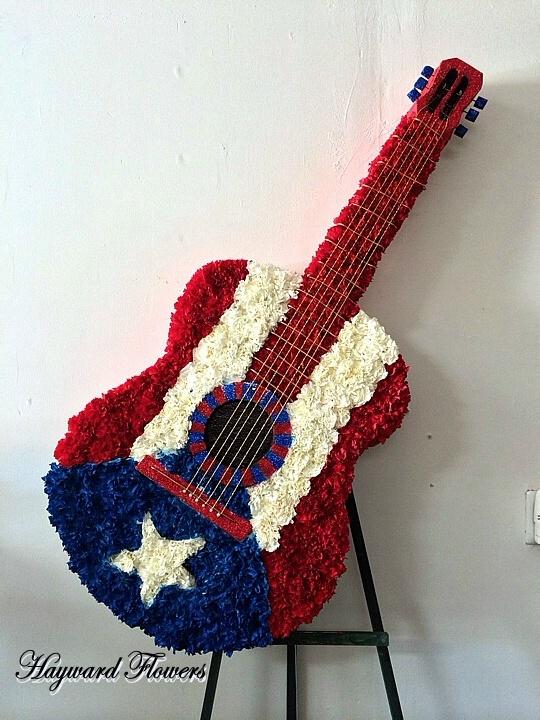 puerto rican guitar floral arrangement
